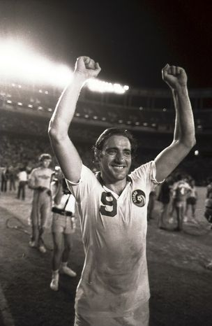 FILE - In this Sept. 18, 1982 file photo, New York Cosmos' Giorgio Chinaglia raises his arms in victory at the conclusion of the Cosmos' 1-0 victory in the Soccer Bowl in San Diego, California. Former Italy and Cosmos star Giorgio Chinaglia died at his home in Florida, Sunday, April 1, 2012, his son Anthony Chinaglia announced. (AP Photo/Lenny Ignelzi, File)