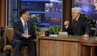 "In this photo provided by NBC, Republican presidential candidate, former Massachusetts Gov. Mitt Romney talks with Jay Leno during his appearance on ""The Tonight Show"" in Burbank, Calif., Tuesday, March 27, 2012. (AP Photo/NBC, Paul Drinkwater)"
