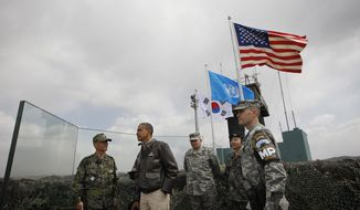 President Obama (second from left) meets March 25, 2012, with members of the South Korean and U.S. militaries at Observation Post Ouellette in the Demilitarized Zone (DMZ), the tense military border between the two Koreas, in Panmunjom, South Korea. (Associated Press)