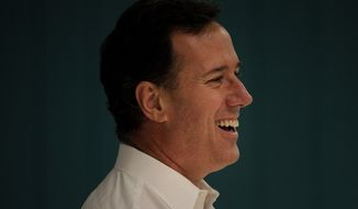 Republican presidential candidate Rick Santorum smiles during a campaign stop in Platteville, Wis., on Saturday, March 31, 2012. (AP Photo/Jae C. Hong)
