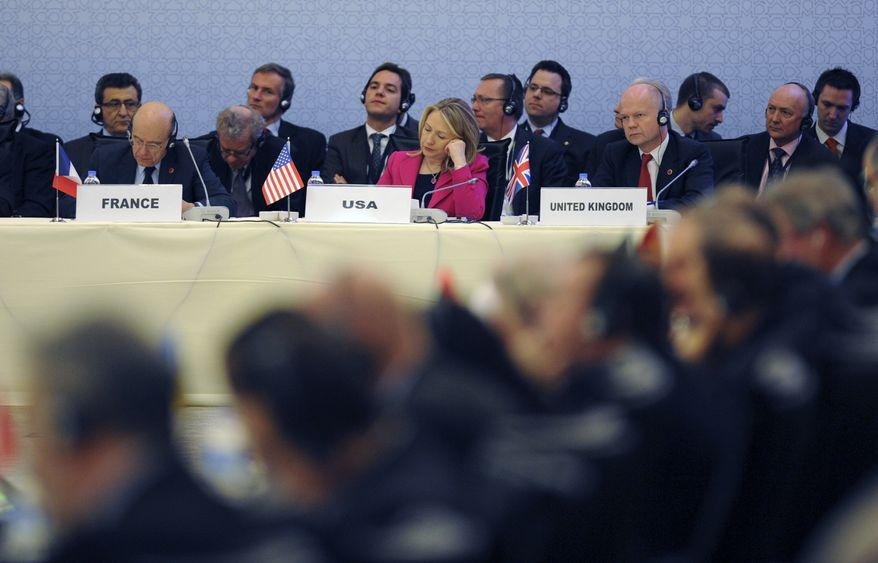 Foreign ministers from dozens of countries, including U.S. Secretary of State Hillary Rodham Clinton (center), gather in Istanbul on Sunday, April 1, 2012, to push for tighter sanctions and diplomatic pressure to further isolate Syrian President Bashar Assad. (AP Photo)