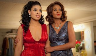 "** FILE ** In this undated file image provided by Sony Pictures Entertainment, singer-actresses Jordin Sparks, left, and Whitney Houston are shown in a scene from the upcoming film ""Sparkle."" Viewers got a first glimpse of Houston's upcoming film Monday, April 2, 2012, when NBC's ""Today"" show premiered a trailer for the much-awaited release. (AP Photo/Sony Pictures, Alicia Gbur, File)"