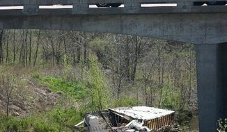 A converted semitrailer that crashed on a Kansas highway Sunday was being driven by a 17-year-old Minnesota boy with a provisional driver's license. (Ottawa Herald via Associated Press)