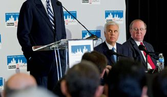 Lewis Katz, left, addresses a news conference while accompanied by William P. Hankowsky, right, and George Norcross III, Monday, April 2, 2012, in Philadelphia. The three are part of group of powerful business leaders that announced Monday that they have closed a deal to purchase Philadelphia's two largest newspapers from hedge funds for approximately $55 million, a fraction of what investors paid for them in 2006.(AP Photo/Matt Rourke)