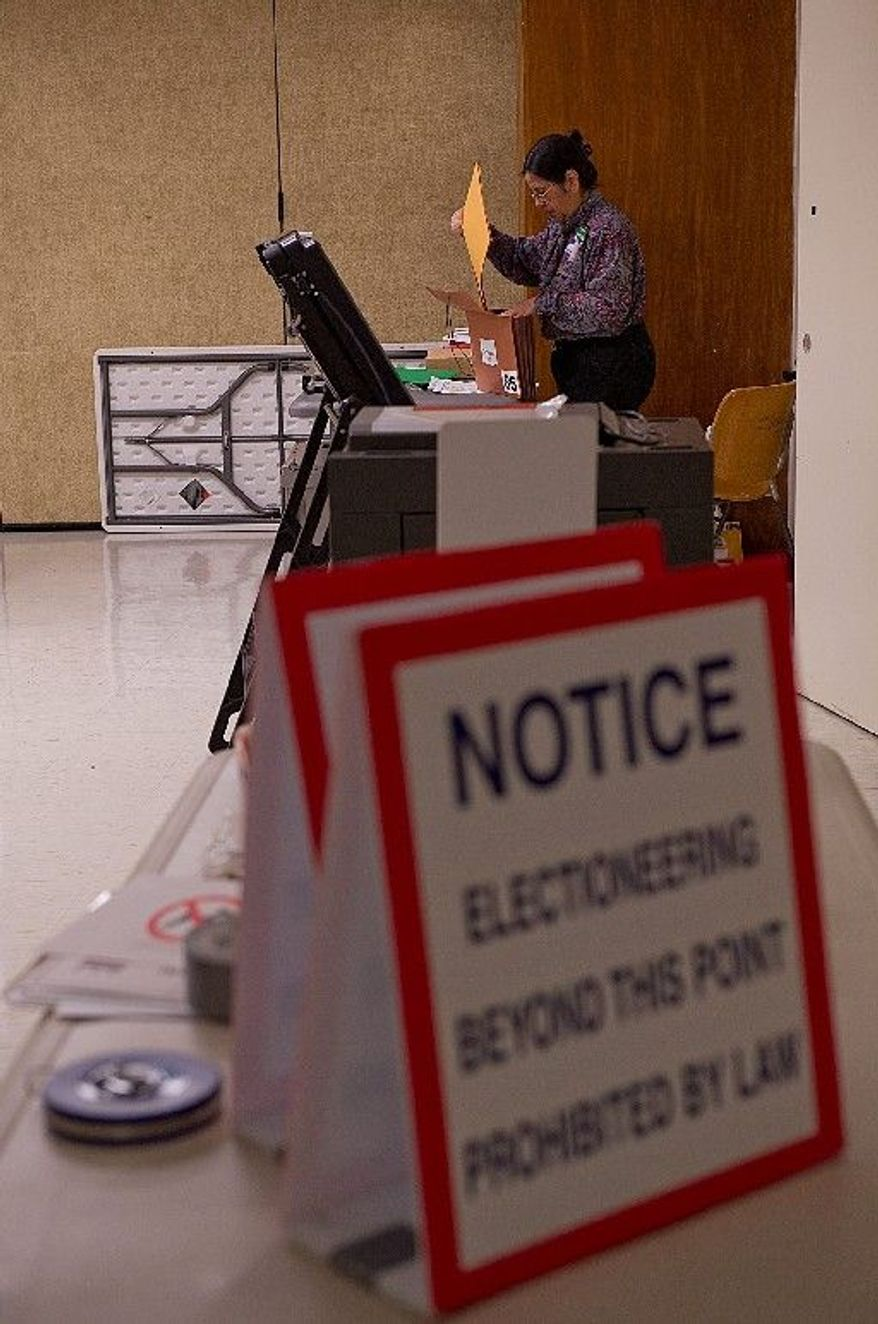 Judith Mangubat, precinct captain for voting Precinct 85, makes sure all the paperwork is in order in anticipation of tomorrow's vote at polling place Specialty Hospital of Washington in Northeast Washington, D.C. on Monday, April 2, 2012. This precinct has a little more than 4,000 registered voters. The polls open at 7 a.m. (Barbara L. Salisbury/The Washington Times)