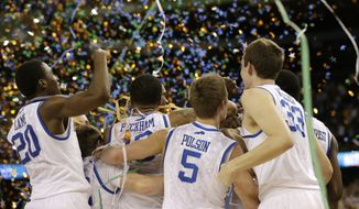Kentucky players celebrate their NCAA tournament championship against Kansas on Monday, April 2, 2012, in New Orleans. Kentucky won 67-59. (AP Photo/David J. Phillip)