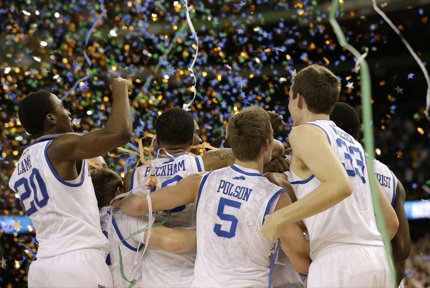 Kentucky players celebrate their NCAA tournament championship against Kansas on Monday, April 2, 2012, in New Orleans. Kentucky won 67-59. (AP Photo/David J. Phillip)