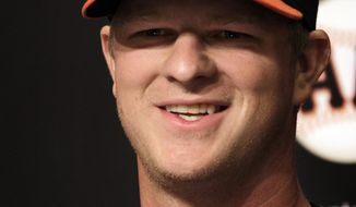 San Francisco Giants pitcher Matt Cain smiles during a news conference Monday, April 2, 2012, in San Francisco. Cain and the Giants agreed Monday to a $127.5 million, six-year contract, the largest deal for a right-handed pitcher in baseball history. The agreement adds $112.5 million over five years to the $15 million salary for 2012 that was remaining in his previous deal. (AP Photo/Ben Margot)