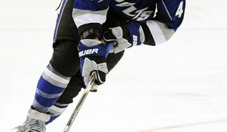 Twenty-one-year-old J.T. Brown was playing for the University of Minnesota-Duluth about a week ago. Now, he's with the Tampa Bay Lightning. The highly-touted prospect will play in his second NHL game against the Washington Capitals on Monday. (AP Photo/Brian Blanco)
