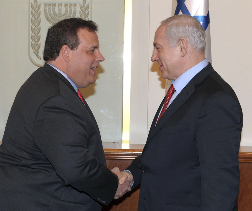 In this photo released by the Israeli Government Press Office, Israeli Prime Minister Benjamin Netanyahu (right) shakes hands April 2, 2012, with New Jersey Gov. Chris Christie during a meeting in Jerusalem. (Associated Press/GPO)