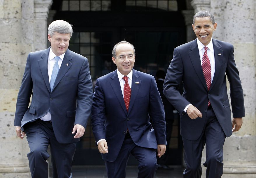 ** FILE ** President Obama (right), Mexican President Felipe Calderon (center) and Canadian Prime Minister Stephen Harper meet for a North American summit in Guadalajara, Mexico, in August 2009. (AP Photo/Alex Brandon, File)