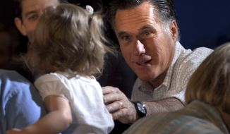 Republican presidential candidate and former Massachusetts Gov. Mitt Romney (right) greets people April 1, 2012, at a pancake breakfast during a campaign stop in Milwaukee, Wis. (Associated Press)