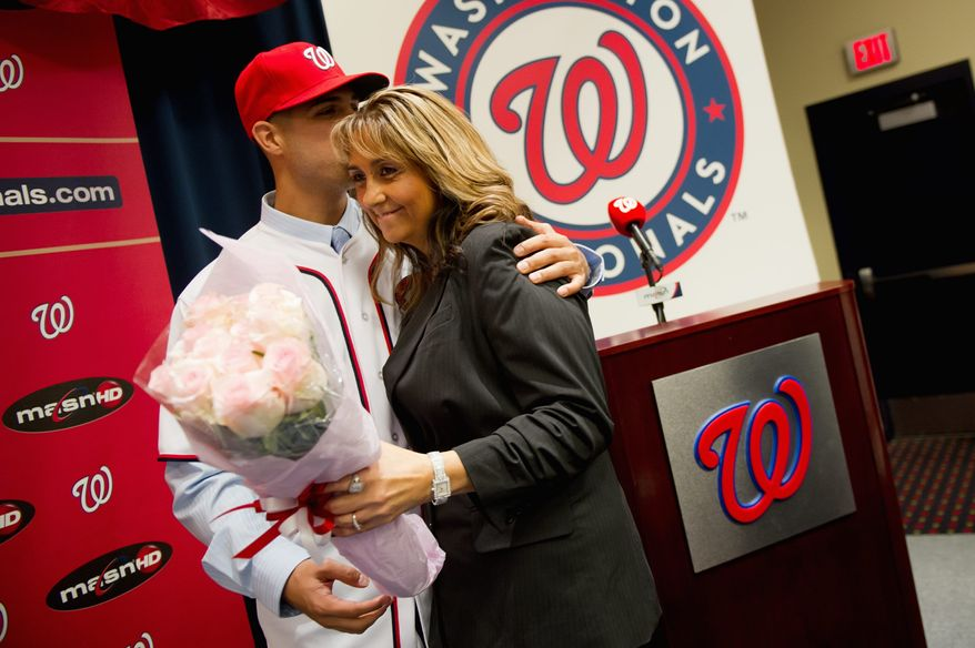Gio Gonzalez gave a bouquet and a kiss to his mother, Yolanda Cid-Gonzalez, when he was introduced as a member of the Washington Nationals in January. (Andrew Harnik/The Washington Times)