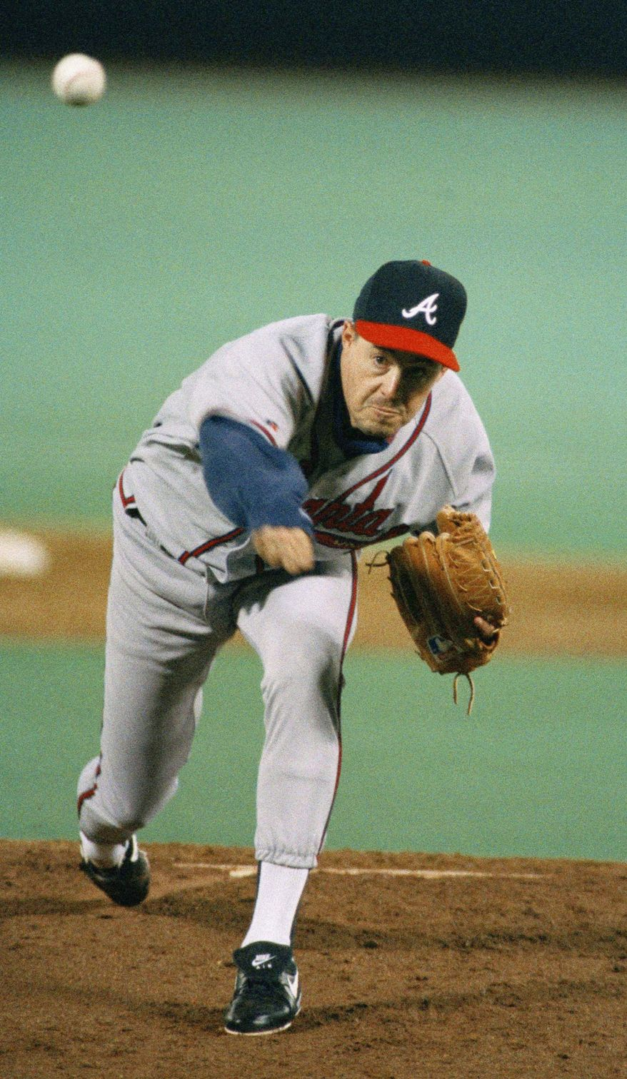 Greg Maddux, anchor of Atlanta's stellar 1990s rotation, won four straight Cy Young awards. (Associated Press)