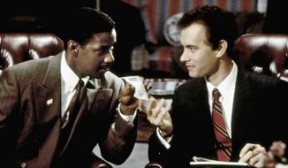 "Denzel Washington and Tom Hanks in ""Philadelphia."" (Associated Press)"