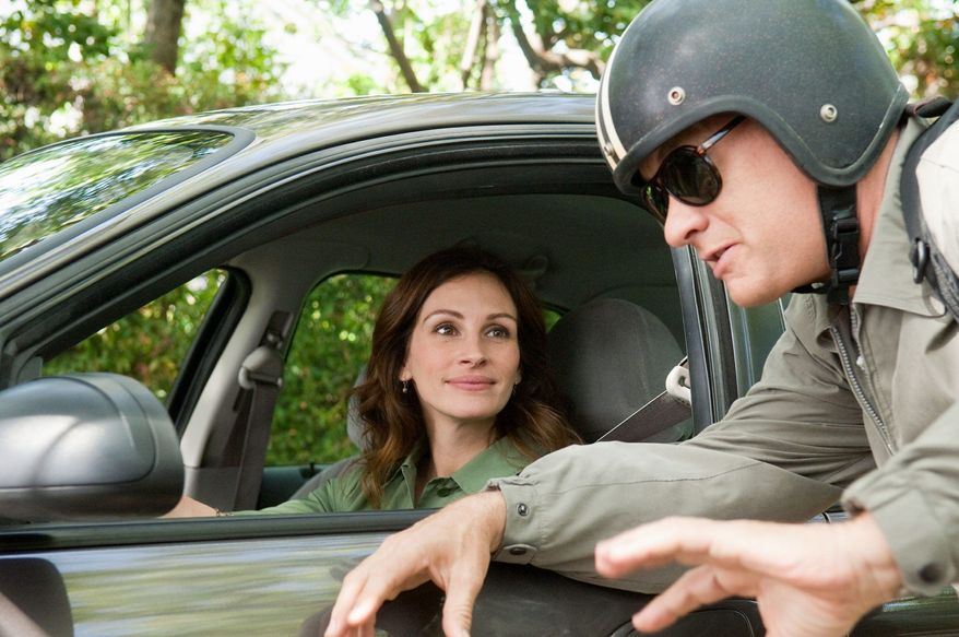 """In this film publicity image released by Universal Pictures, Julia Roberts, left, and Tom Hanks are shown in a scene from """"Larry Crowne."""" (AP Photo/Universal Pictures, Bruce Talamon)"""