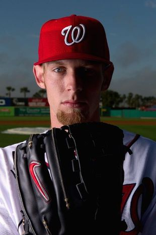 """""""The break is coming back. Now it's just fine-tuning it and picking a spot where I want to start it, and committing to it,"""" Nationals ace Stephen Strasburg said. Washington will limit Strasburg, shown below in a spring training game, to about 160 innings this season. (Andrew Harnik/The Washington Times)"""