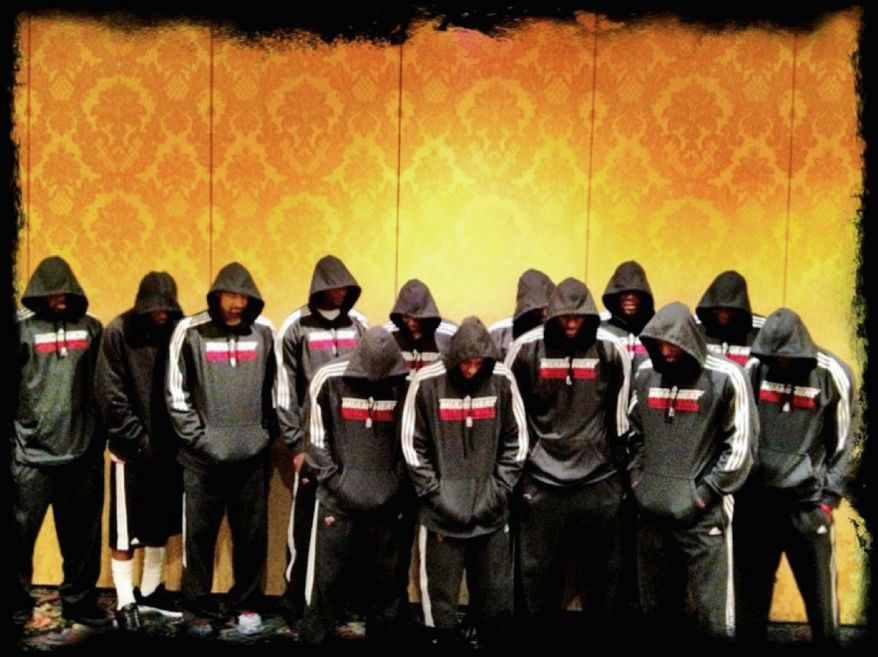 In March 2012, then-Miami Heat star LeBron James tweeted this photo of him and his teammates donning hoodies for a team photo as a tribute to Trayvon Martin, the Florida youth slain a month earlier. (Associated Press)