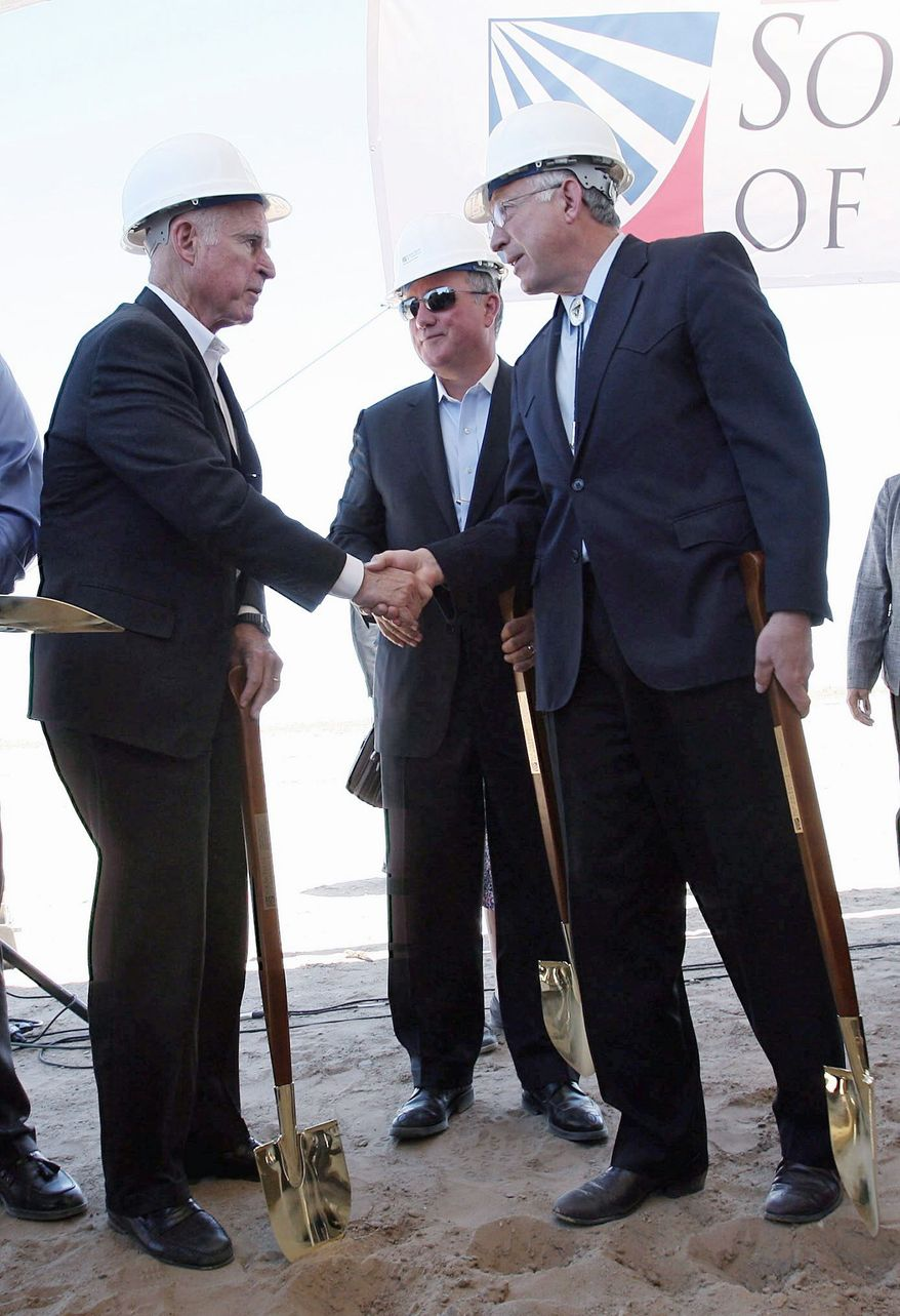 California Gov. Jerry Brown (left), Interior Secretary Kenneth L. Salazar (right) and Uwe T. Schmidt of Solar Trust attend an event near Blythe, Calif., for the Blythe Solar Power Project in June. (Associated Press)