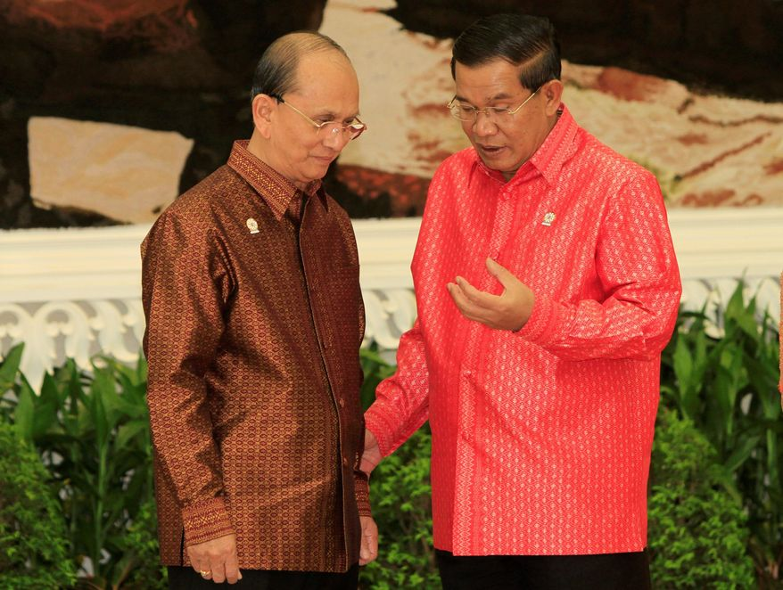 Cambodian Prime Minister Hun Sen (right) talks with Thein Sein, Myanmar's president, in Phnom Penh on Monday before the welcome dinner ahead of the 20th ASEAN Summit slated for Tuesday and Wednesday in Cambodia. (Associated Press)