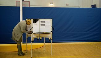 D.C. Council member Yvette Alexander, Ward 7 Democrat, casts her vote at the Randle-Highlands Elementary School precinct in Southeast on Tuesday. (Rod Lamkey Jr./The Washington Times)