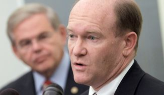 Rep. Chris Coons, Delaware Democrat, accompanied by Sen. Robert Menendez, New Jersey democrat, talks about the Palestinian effort to seek U.N. recognition of statehood, Tuesday, Sept. 20, 2011, during a news conference on Capitol Hill in Washington. (AP Photo/J. Scott Applewhite) **FILE**