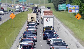Traffic traveling on interstate 59-N/20-E is being diverted at Academy Drive in Bessemer, Ala., Monday, April 2, 2012. (AP Photo/Birmingham News Photo,Jeff Roberts)