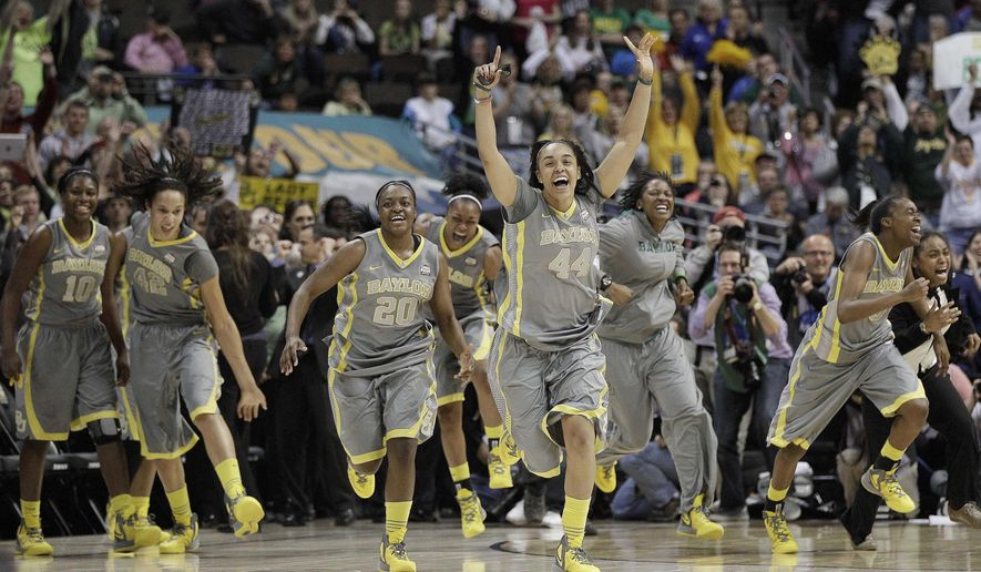 The Baylor team explodes off the bench at the end of the second half in the NCAA Women's Final Four college basketball championship game against Notre Dame, in Denver, Tuesday, April 3, 2012. Baylor won the championship 80-61. (AP Photo/Eric Gay)