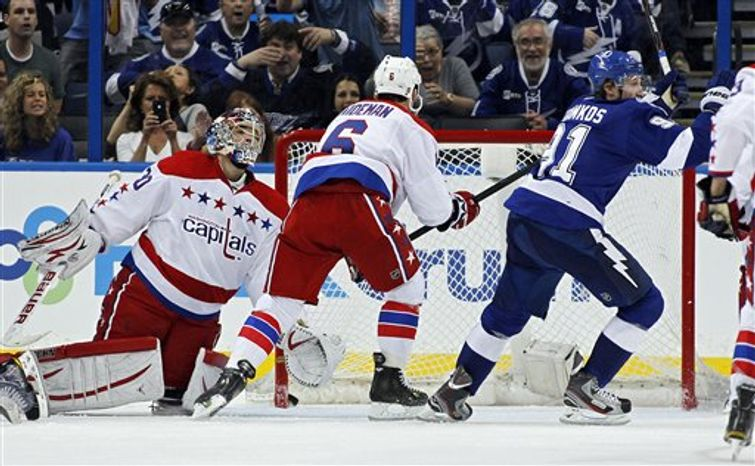 Michal Neuvirth allowed three goals on 26 shots Monday in the Capitals' loss at the Lightning. (Associated Press)