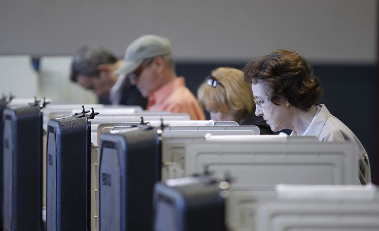 Voters cast their ballot at a polling place during a primary election in Frederick, Md., Tuesday, April 3, 2012. (AP Photo/Luis M. Alvarez)