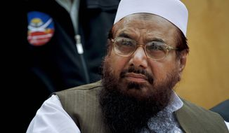 ** FILE ** Lashkar-e-Taiba founder Hafiz Mohammad Saeed attends a ceremony in Islamabad, Pakistan, in April 2011. (AP Photo/Anjum Naveed)