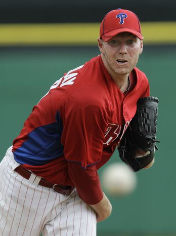 Philadelphia Phillies starting pitcher Roy Halladay delivers a warmup pitch before facing the Toronto Blue Jays during their spring training baseball game in Clearwater, Fla., Saturday, March 31, 2012. (AP Photo/Kathy Willens)
