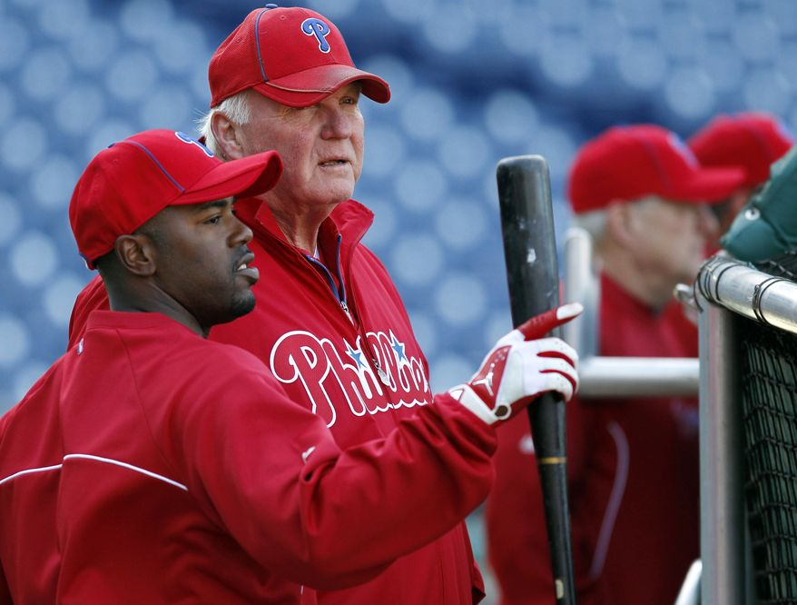Philadelphia Phillies shortstop Jimmy Rollins, left, talks with manager Charlie Manuel before the Phillies' exhibition baseball game with the Pittsburgh Pirates on Monday, April 2, 2012, in Philadelphia. (AP Photo/Alex Brandon)