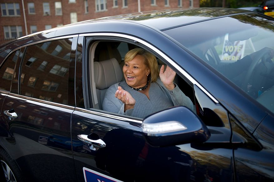 D.C. Council member Yvette Alexander arrives to vote at her Ward 7 precinct at Randle Highlands Elementary School in Washington as the nation's capital holds its primary election on Tuesday, April 3, 2012. (Rod Lamkey Jr./The Washington Times)
