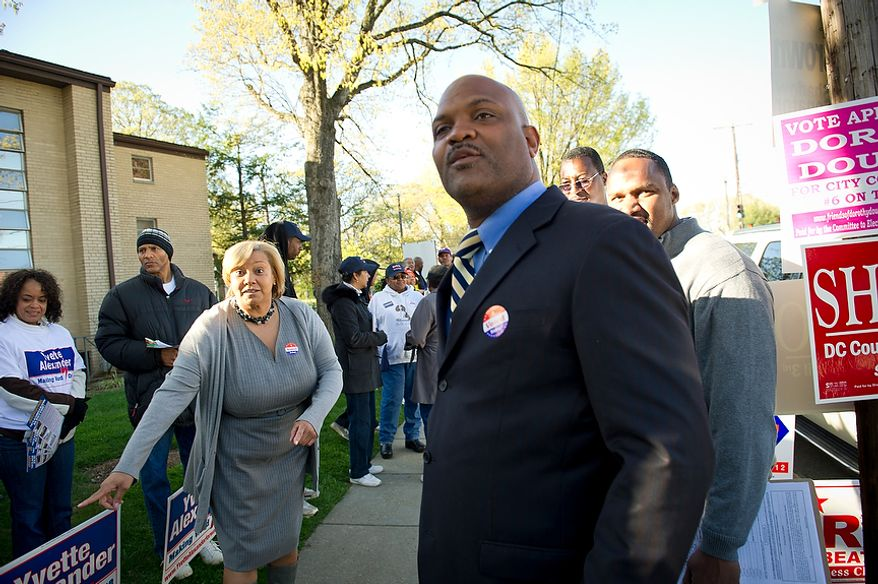 D. C. Council member Yvette Alexander (left), Ward 7 Democrat, and challenger Tom Brown (right) chat with supporters and passing voters at St. Timothy's Episcopal Church in Washington as the nation's capital holds its primary election on Tuesday, April 3, 2012. (Rod Lamkey Jr./The Washington Times)
