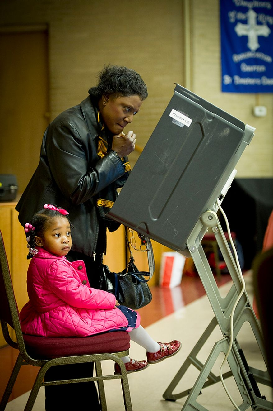 Michele Hamlett-Crayon is joined by her granddaughter Keyasia Crayon, 2 1/2, as she votes at St. Timothy's Episcopal Church in Washington as the nation's capital holds its primary election on Tuesday, April 3, 2012. (Rod Lamkey Jr./The Washington Times)