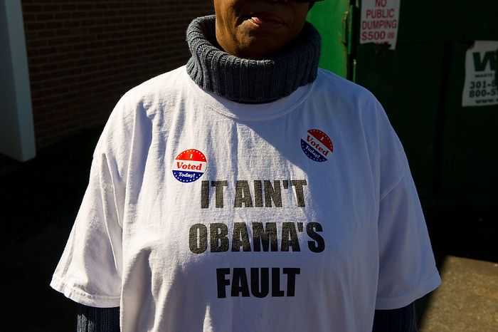 """Ward 8 resident Teresa Stuart wears """"I Voted Today!"""" stickers on her """"It Ain't Obama's Fault"""" T-shirt after casting her ballot at Precinct 116 inside the New Image Baptist Church on Alabama Avenue Southeast in Washington on Tuesday, April 3, 2012. (Andrew Harnik/The Washington Times)"""