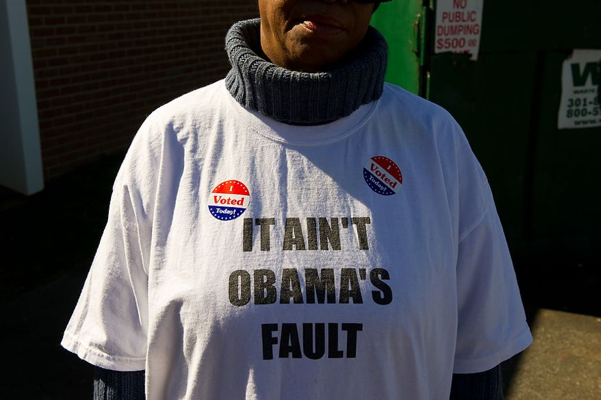 "Ward 8 resident Teresa Stuart wears ""I Voted Today!"" stickers on her ""It Ain't Obama's Fault"" T-shirt after casting her ballot at Precinct 116 inside the New Image Baptist Church on Alabama Avenue Southeast in Washington on Tuesday, April 3, 2012. (Andrew Harnik/The Washington Times)"