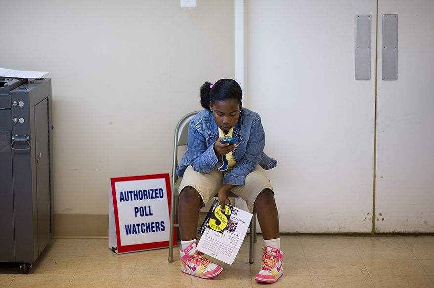 Ward 8 resident Gabrielle Johnson, 8, waits for her mother to cast her vote at Precinct 116 inside the New Image Baptist Church on Alabama Avenue Southeast in Washington on Tuesday, April 3, 2012. (Andrew Harnik/The Washington Times)