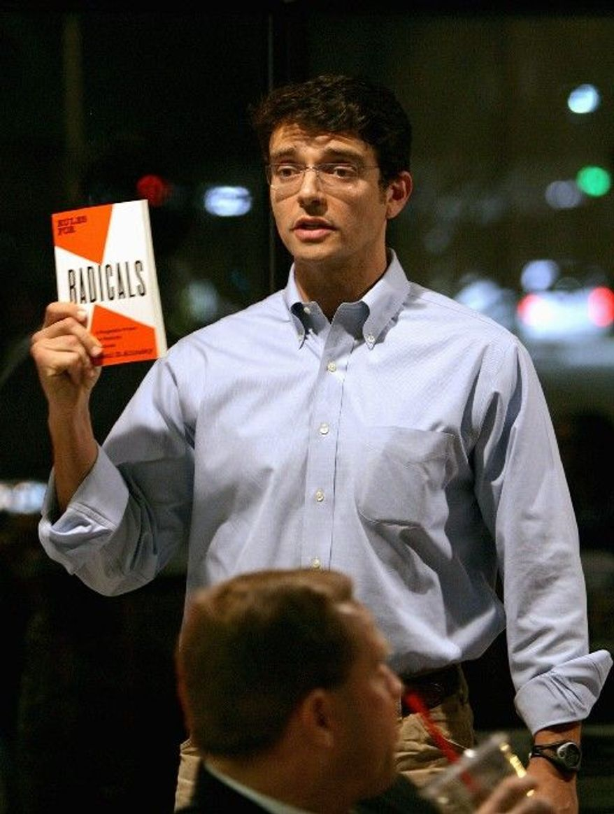 "Ilario Pantano, who is seeking to become the Republican nominee to challenge Democratic Rep. Mike McIntyre in North Carolina's 7th congressional district, suggests Saul Alinsky's book ""Rules for Radicals"" as reading material during a meeting of supporters of the Fair Tax in Wilmington, NC, Wednesday, February 3, 2010. (AP Photo/Logan Wallace)"