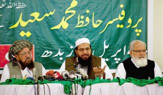 The U.S. State Department has placed a $10 million bounty on Hafiz Mohammad Saeed (center), who founded the militant group Lashkar-e-Taiba. (Associated Press)