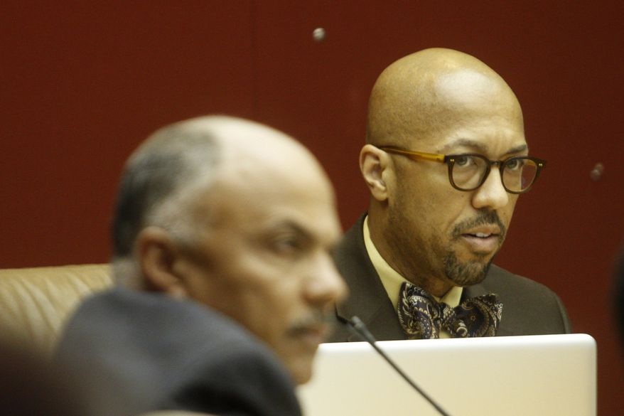 Detroit City Council President Charles Pugh responds during the open public forum during a Detroit City Council meeting discussing the city consent agreement on Wednesday, April, 4, 2012. The city of Detroit was moving closer to avoiding a state-appointed emergency manager Wednesday. A state-appointed review team approved an agreement between the state and city to fix Detroit's troubled finances. (AP Photo/Detroit Free Press, Jarrad Henderson)