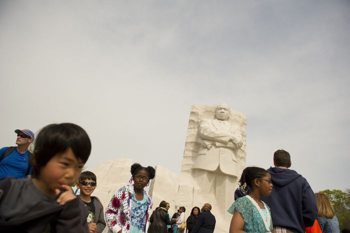 Youths walk around under cloudy skies, at the Martin Luther King Jr. Memorial on the National Mall in Washington, D.C., Wednesday, April 4, 2012, on the 44th anniversary of the 1968 assassination of Dr. Martin Luther King, Jr. (Rod Lamkey Jr/The Washington Times)