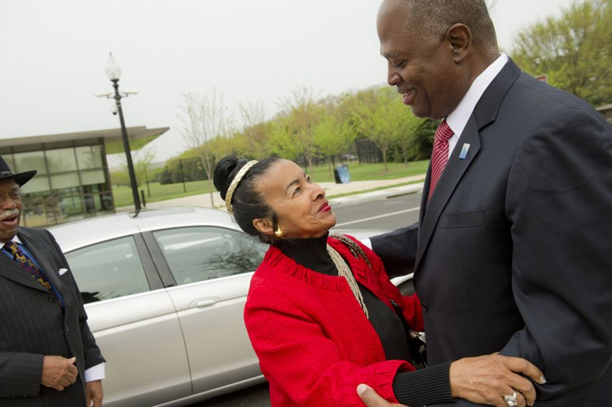 Dr. Xernona Clayton, President & CEO Trumpet Awards Foundation, Inc., (left) gets a hug from Harry E. Johnson, Sr., President, Washington D.C. Martin Luther KIng Jr. National Memorial Project Foundation, Inc. (right) prior to the  2012 Wreath-Laying Ceremony for the 44th anniversary of the 1968 assassination of Dr. Martin Luther King, Jr. (Rod Lamkey Jr/The Washington Times)