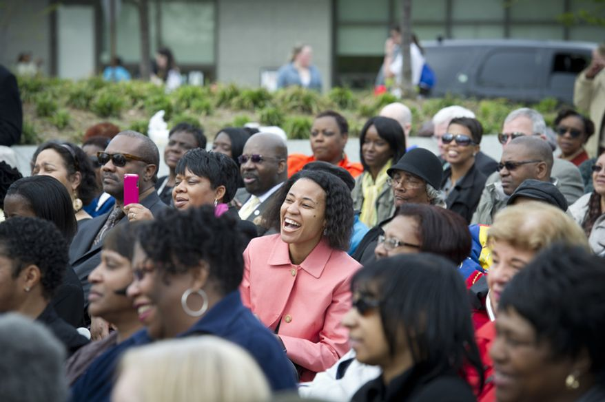 The crowd shares in a light moment during remarks about a funny story involving Dr. Martin Luther King, Jr., during the Fair Housing Month 2012 Wreath-Laying Ceremony for the 44th anniversary of the 1968 assassination of Dr. Martin Luther King, Jr. (Rod Lamkey Jr/The Washington Times)