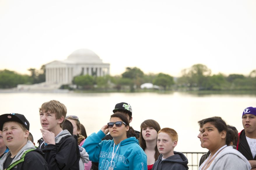 Kids visit the Martin Luther King Jr. Memorial on the National Mall. (Rod Lamkey Jr/The Washington Times)