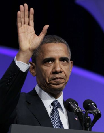 President Obama waves as he leaves the Associated Press luncheon during the annual convention of the American Society of Newspaper Editors on Tuesday, April 3, 2012, in Washington. (AP Photo/Carolyn Kaster)