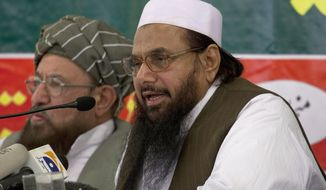 Hafiz Mohammad Saeed (right), chief of Jamaat-ud-Dawwa and founder of Lashkar-e-Taiba, addresses a news conference April 4, 2012, with anti-American cleric Sami ul Haq in Rawalpindi, Pakistan. (Associated Press)