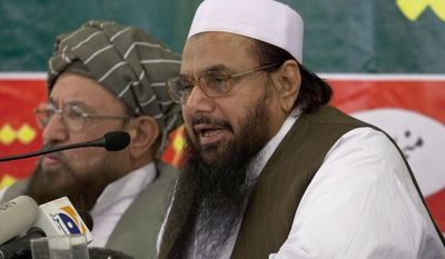 Hafiz Mohammad Saeed (right), chief of Jamaat-ud-Dawwa and founder of Lashkar-e-Taiba, addresses a news conference April 4, 2012, with anti-American cleric Sami ul Haq in Rawalpindi, Pakistan. (Associated Press)