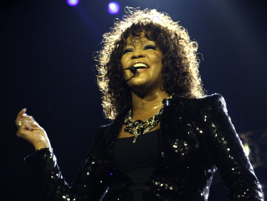 ** FILE ** In this April 25, 2010 file photo, singer Whitney Houston performs at the o2 in London as part of her European tour. An autopsy report shows that cocaine was found in Houston's system and that investigators recovered white powdery substances from her hotel room. Houston died Feb. 11, in California at the age of 48. (AP Photo/Joel Ryan, file)